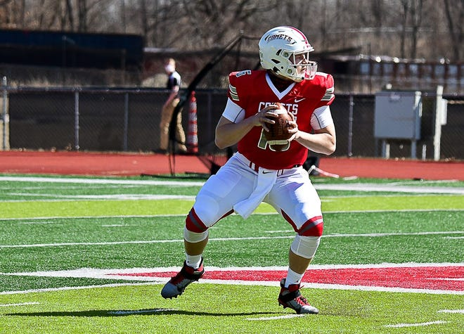Olivet College quarterback Kaleb Jarrett looks downfield in a MIAA game earlier this spring against Kalamazoo College. Division III schools like Olivet College and Albion College are playing spring football after the fall season was postponed due to COVID concerns.