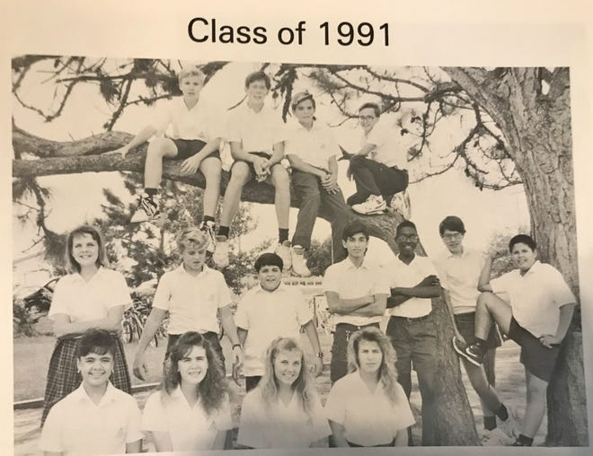 The 8th grade graduating Class of 1991 at Divine Mercy Catholic School on Merritt Island. FLORIDA TODAY's Tim Walters is crouching on the tree branch, top right.