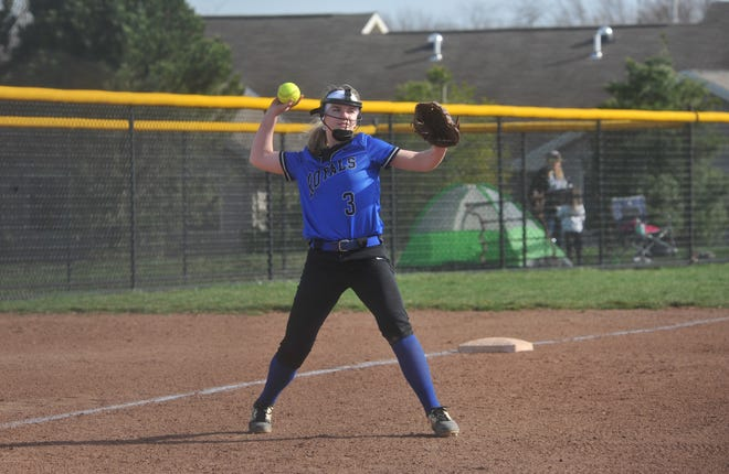Wynford's Alli Scott throws a ball to first base to keep loose between innings.
