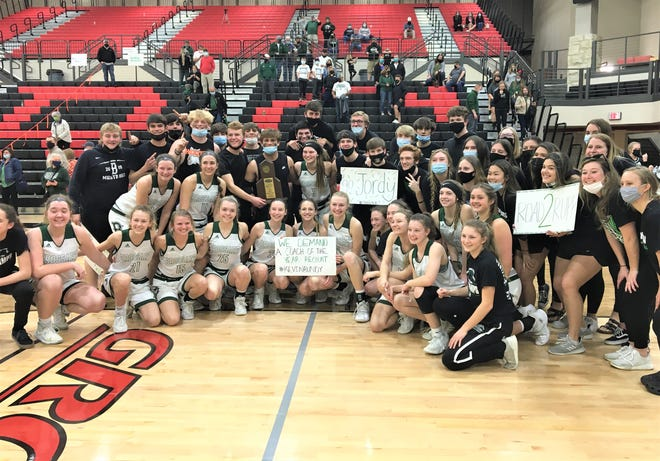 Brossart players and student supporters with the trophy as Bishop Brossart defeated Montgomery County 61-47 in the KHSAA 10th Region girls basketball championship game March 30, 2021 at George Rogers Clark High School, Winchester, KY.