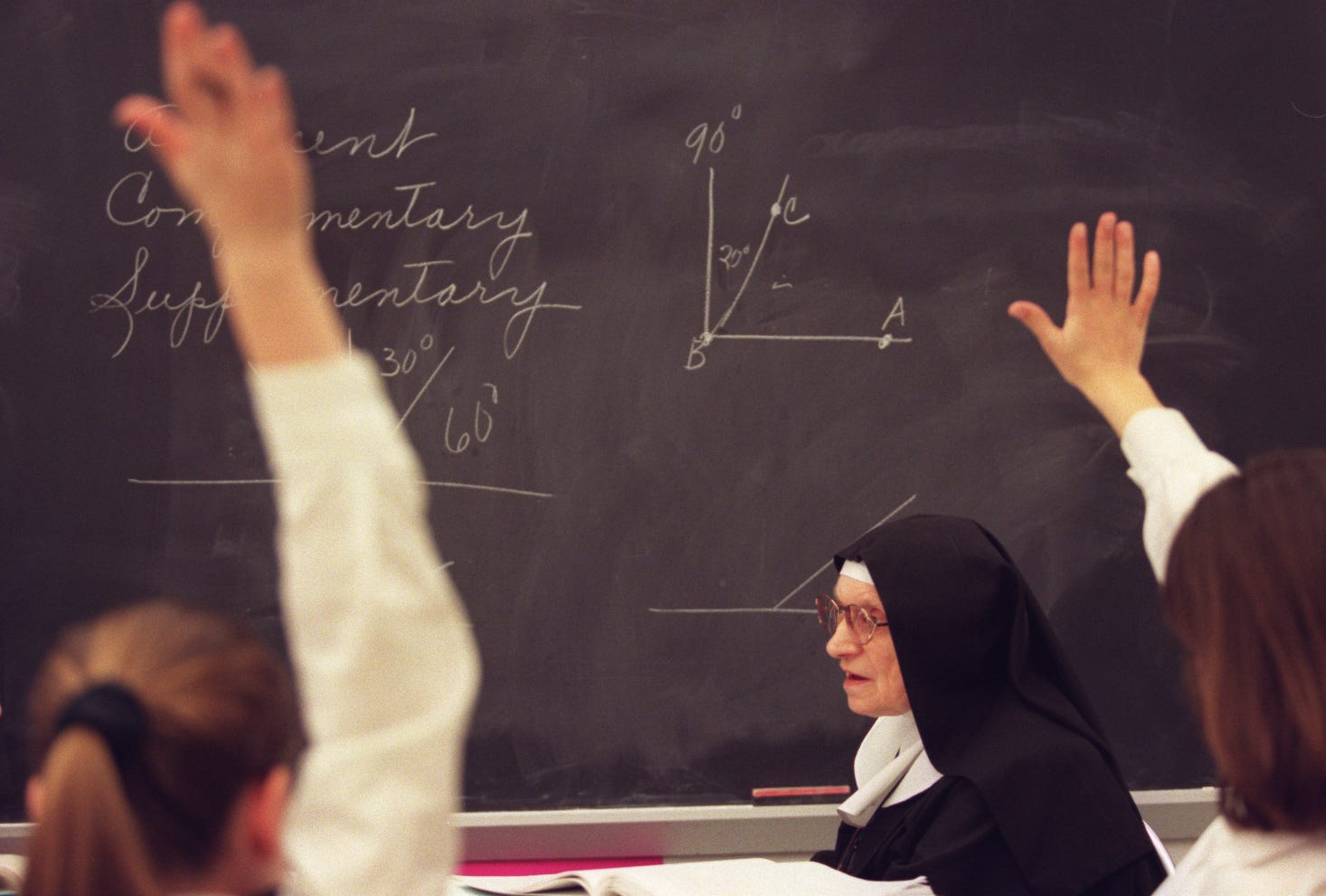 The Spiritus Sanctus Academy is a small Catholic grade school backed by Tom Monaghan that features daily mass, school uniforms, nuns in habits and daily religion class. Mother Regina Mary teaches 8th-grade math on April 24, 1997.