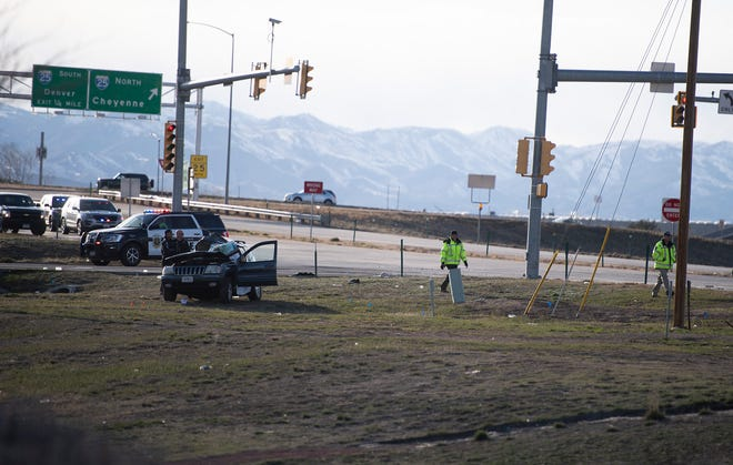 Law enforcement work the scene of a crash at the intersection of Southeast Frontage Road and Colorado Highway 14 in Fort Collins, Colo. on Tuesday, March 30, 2021.