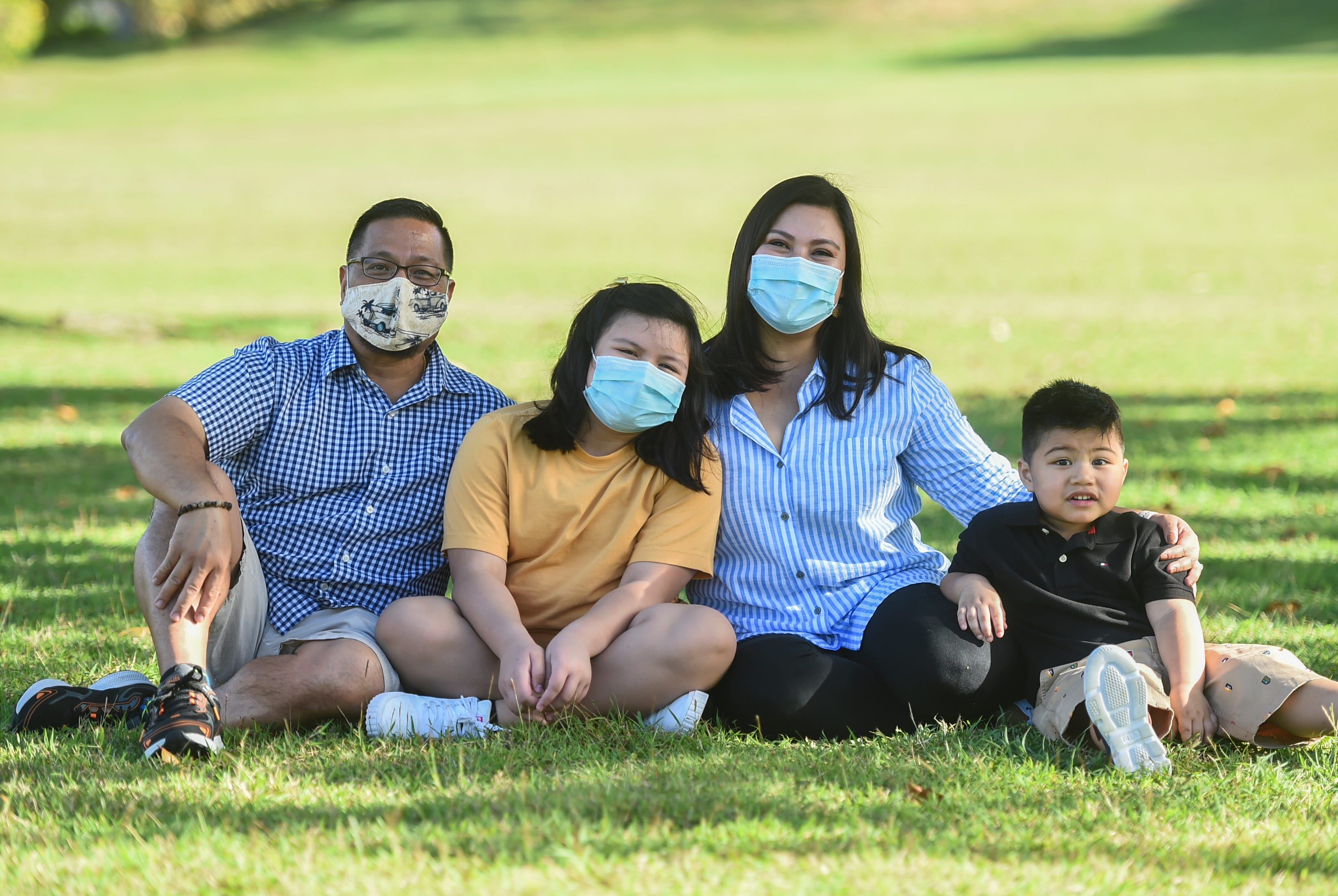 Patrick and Jenny Luces with their children, Patrick Jordan Luces, 3, and Samantha De Leon, 10, at Gov. Joseph Flores Beach Park in Tumon, March 19, 2021.