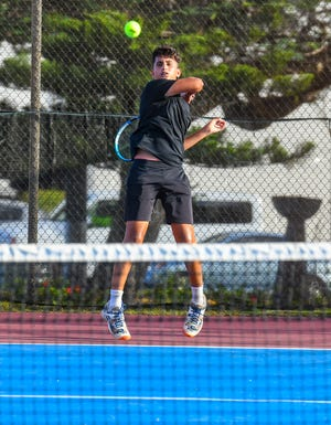 Aarman Sachdev hits a backhand during the high school tennis finals held March 31. Sachdev also won the boys 18-U finals at the 49th Chamorro Open, which concluded April 11 at the Guam National Tennis Center.
