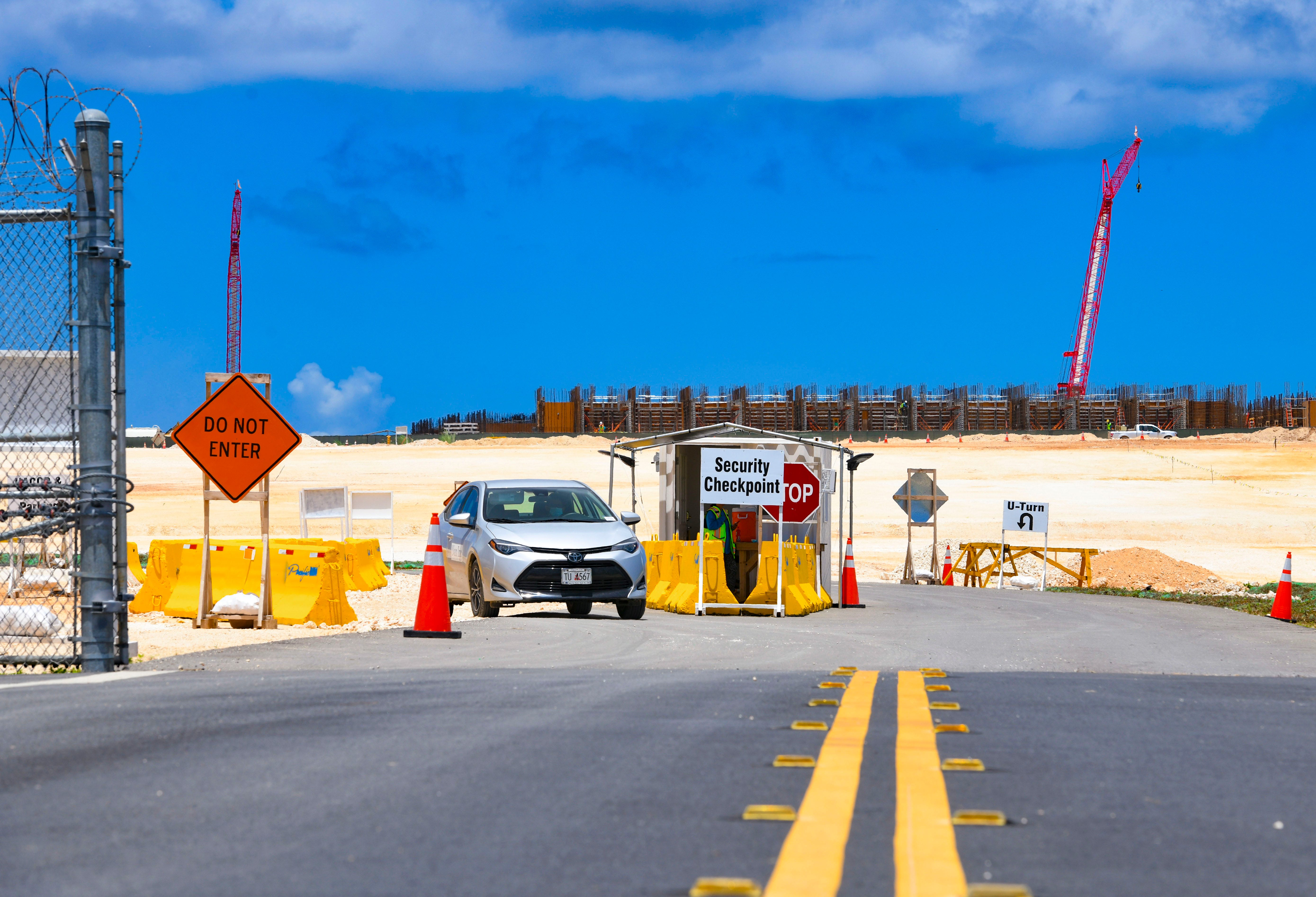 A driver passes a security checkpoint as it prepares to exit the Marine Corps Base Camp Blaz still under construction on Wednesday, March 31, 2021.
