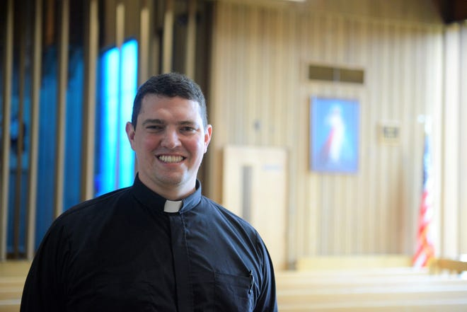 Matthew Frisbee, pastor of Resurrection Parish and St. Mary of the Snows.
