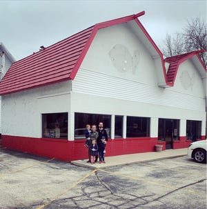 Zach and Becky Kinzer standing outside the former South Milwaukee Dairy Queen set to become the brick-and-mortar location for Better Together Cafe.
