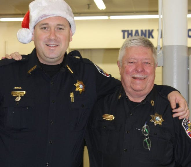 Former Rutherford County Sheriff Robert Arnold poses with former Chief Deputy Randy Garrett.