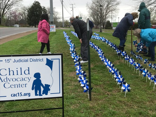 Volunteers set up 318 pinwheels in Lebanon on March 31, 2021. The pinwheels represent the number of children served by the 15th Judicial District Child Advocacy Center because of reports of child abuse in 2020.