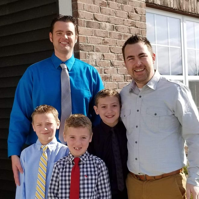 John McClanahan and John Reynolds along with their three kids. McClanahan and Reynolds were the first gay members accepted by Towne View Baptist Church in Kennesaw, Ga., in fall 2019.
