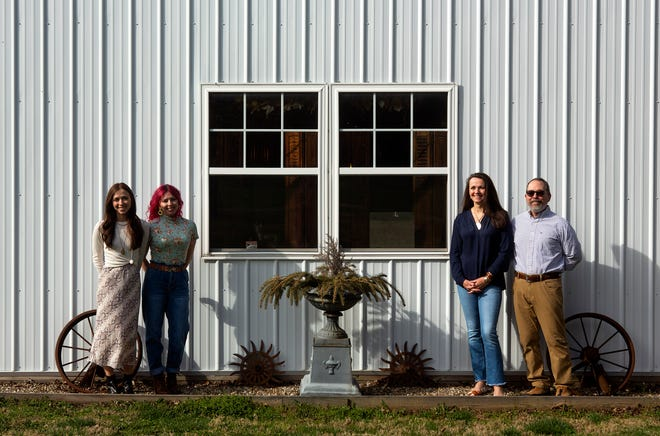 (Left to right) Heather Clevenger, of Granville, Sarah Reed, of Pataskala and their mother and father Sandy and David Arruda, of Newark, stand in front of the pole barn where all four of them own a business called The Curators' Barn on March 30, 2021 in Newark, Ohio. The Curators' Barn is a pop up shop which is focused on selling an eclectic mix of of handmade, repurposed and vintage items.
