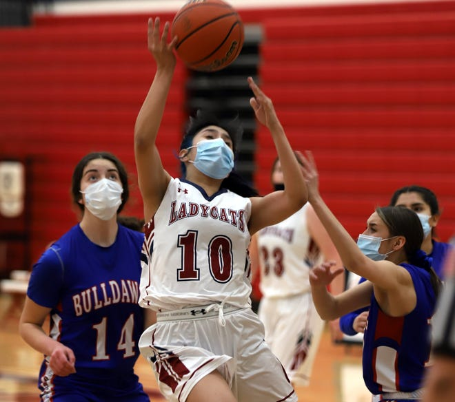 Senior Lady 'Cat Jenae Jasso found a lane to the basket against Las Cruces High on Tuesday for two of her seven points. The Bulldawgs finished the District 3-5A contest with a 47-36 victory at Deming High.