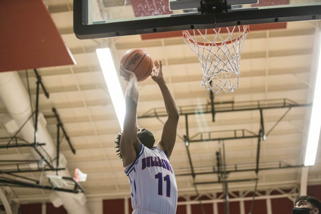 Abraham Mitchell (11) goes for a layup as the Las Cruces Bulldawgs face off against the Deming Wildcats at Las Cruces High School in Las Cruces on Tuesday, March 30, 2021.