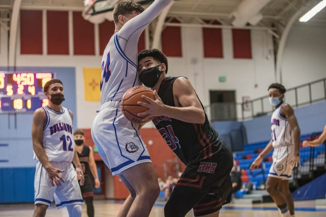 Christian Pacheco (34) tries to work past a defender as the Las Cruces Bulldawgs face off against the Deming Wildcats at Las Cruces High School in Las Cruces on Tuesday, March 30, 2021.