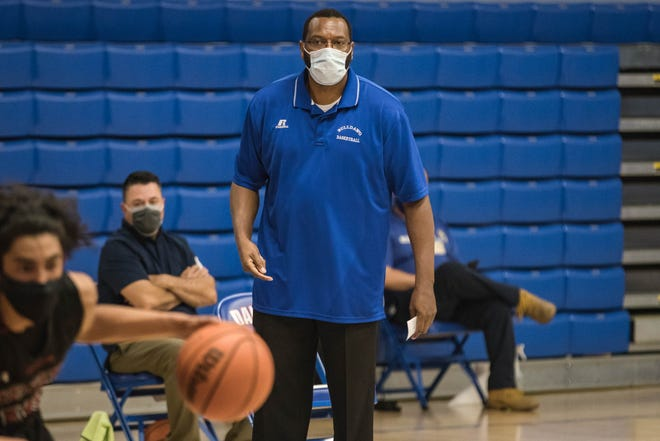 Head coach William Benjamin watches from the sidelines as the Las Cruces Bulldawgs face off against the Deming Wildcats at Las Cruces High School in Las Cruces on Tuesday, March 30, 2021.
