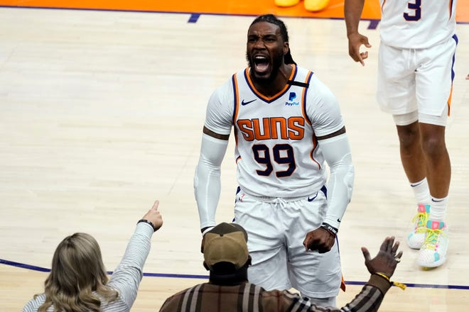 Phoenix Suns forward Jae Crowder (99) acknowledges the fans after scoring against the Atlanta Hawks during the second half of an NBA basketball game, Tuesday, March 30, 2021, in Phoenix. Phoenix won 117-110. (AP Photo/Rick Scuteri).