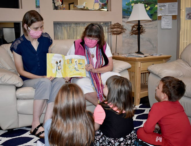 April Schalk and Alison Lanza Falls, of the United Way in Ottawa County, introduce Alexya and Kennedy Henson and Kaiden Bowen to Imagination Library.