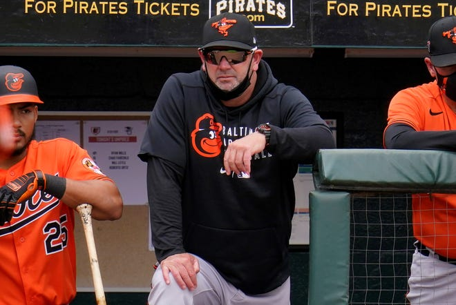 Baltimore Orioles manager Brandon Hyde stands on the dugout steps during a spring training exhibition baseball game against the Pittsburgh Pirates in Bradenton, Fla., Monday, March 22, 2021. (AP Photo/Gene J. Puskar)