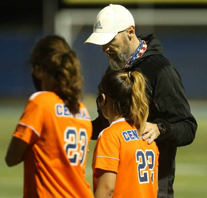 San Angelo Central High School head girls soccer coach Ben Henry talks to the Lady Cats during a home game in the 2021 season.