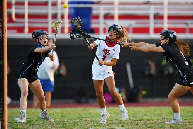 Vero Beach High School's Alexa Vega (3) shoots and scores the first of her six goals against Hagerty on March 30 at the Citrus Bowl.