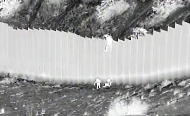U.S. Border Patrol agents rescued two young children who were dropped by smugglers from the border fence and abandon Tuesday near Mount Cristo Rey.