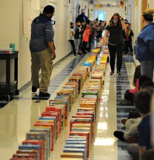 Zane Grey Elementary students watch as the boxes were knocked down like dominoes on Wednesday. The fun activity capped the Cereal Box Drive the school held in the past month, as more than 5,000 boxes were collected and will be donated to various organizations throughout the city.
