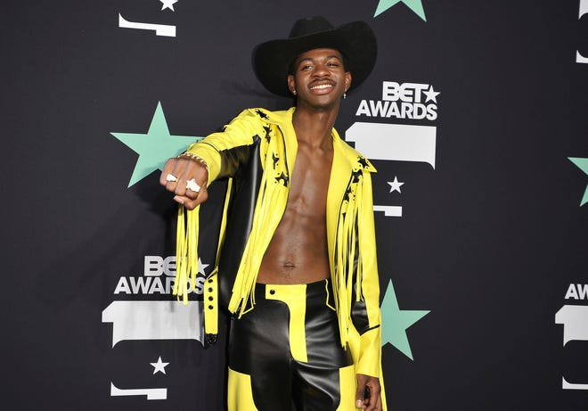In a Sunday, June 23, 2019 file photo, Lil Nas X poses in the press room at the BET Awards, at the Microsoft Theater in Los Angeles.
