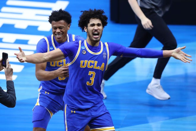 UCLA Bruins guard Johnny Juzang (3) celebrates after defeating the Michigan Wolverines in the Elite Eight of the 2021 NCAA Tournament at Lucas Oil Stadium.