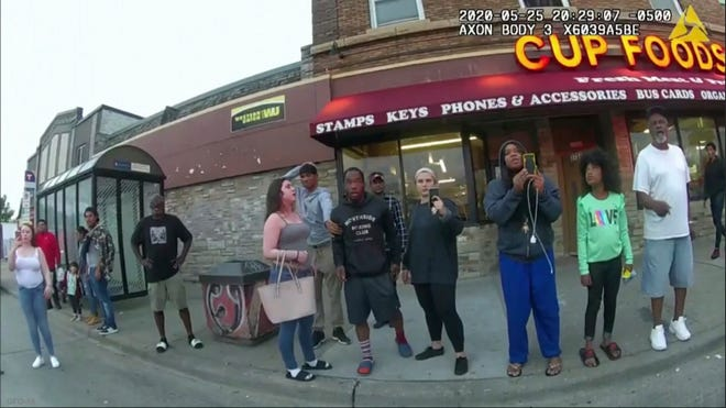 This May 25, 2020, file image from a police body camera shows bystanders including Alyssa Funari, left filming, Charles McMillian, center left in light colored shorts, Christopher Martin center in gray, Donald Williams, center in black, Genevieve Hansen, fourth from right filming, Darnella Frazier, third from right filming, as former Minneapolis police officer Derek Chauvin was recorded pressing his knee on George Floyd's neck for several minutes in Minneapolis.