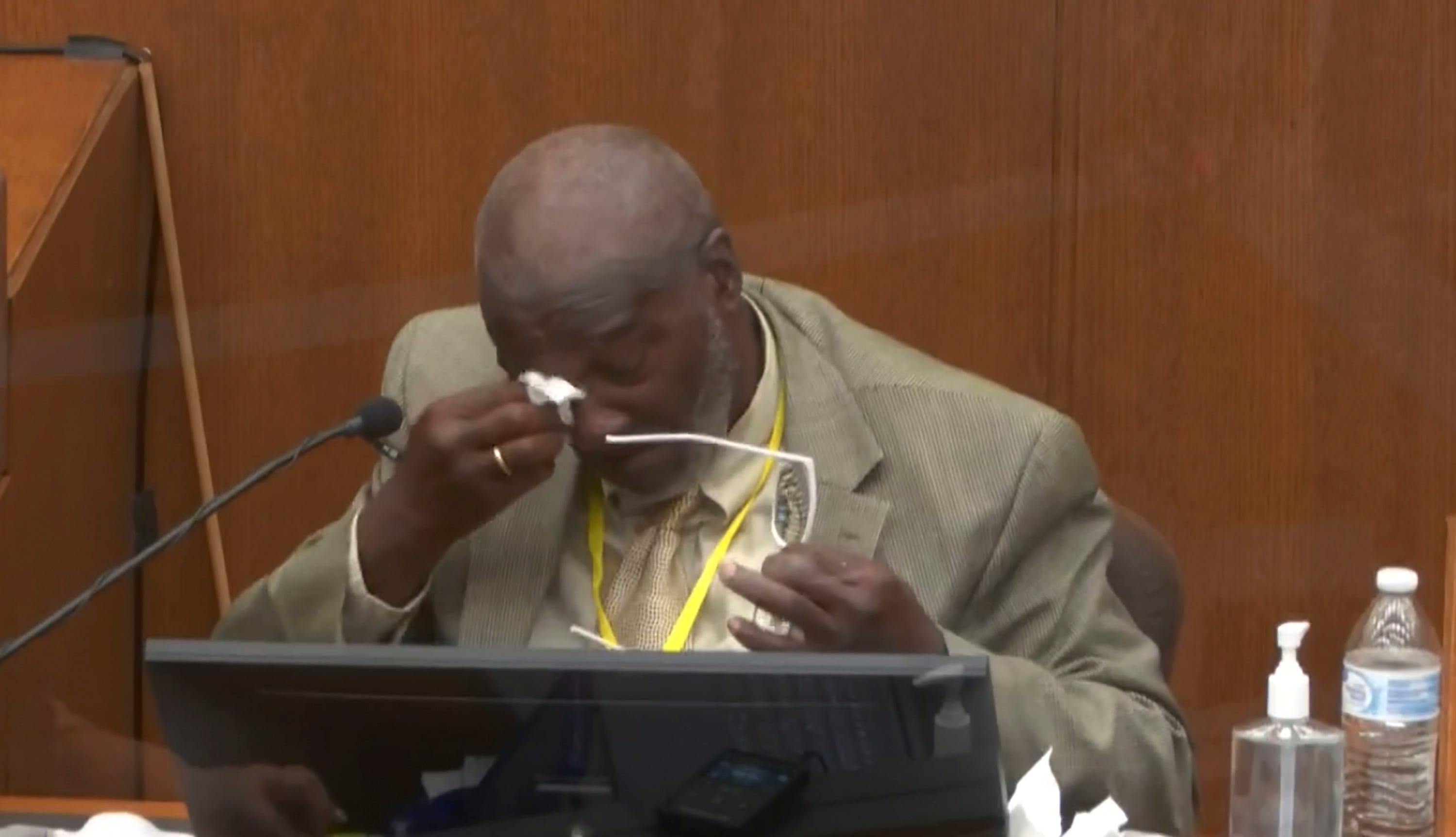 Witness Charles McMillian becomes emotional as he answers questions March 31 in the trial of former Minneapolis police officer Derek Chauvin at the Hennepin County Courthouse in Minneapolis.
