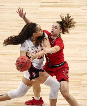 Stanford guard Haley Jones controls the ball while defended by Louisville guard Mykasa Robinson.