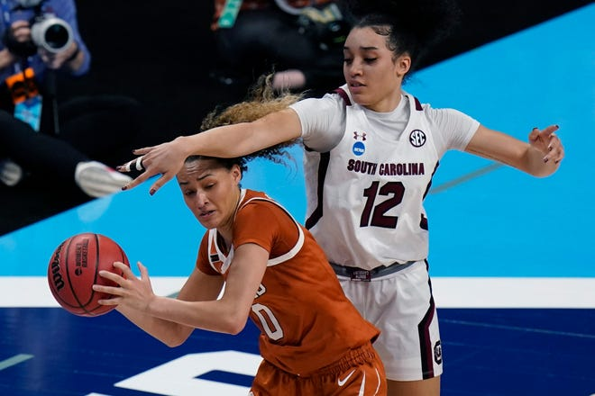 Texas guard Celeste Taylor is pressured by South Carolina guard Brea Beal.