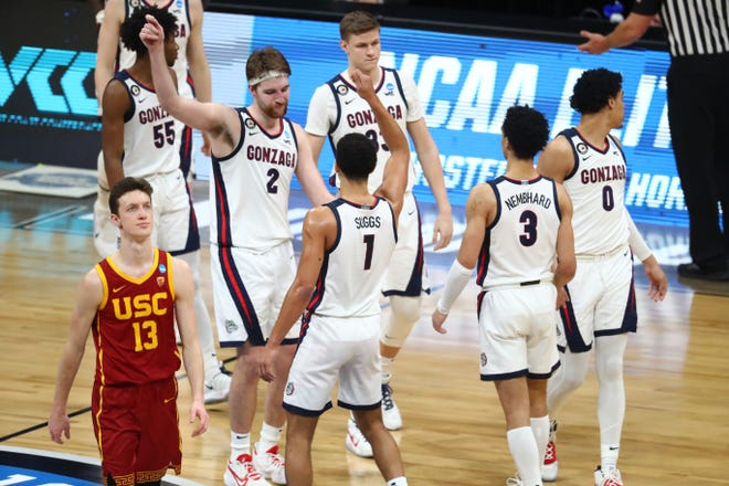 Gonzaga Bulldogs celebrate after the game in the Elite Eight of the 2021 NCAA Tournament against the Southern California Trojans at Lucas Oil Stadium.