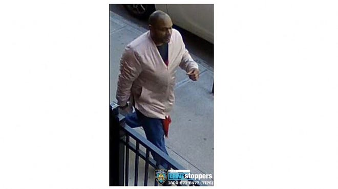 This image released on March 30, 2021, on its Twitter feed (@NYPDTips) by the New York Police Department Crime Stoppers shows a man wanted in connection of an assault on a 65-year-old Asian American woman on March 29, 2021.