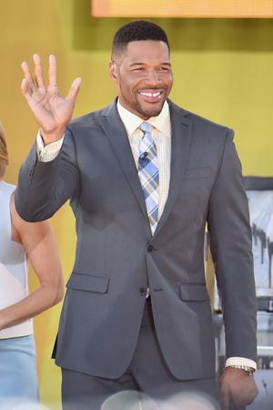 "Michael Strahan shared a video of him having a procedure done to remove his signature tooth gap. Even his ""Good Morning America"" co-hosts aren't sure if it's for real."