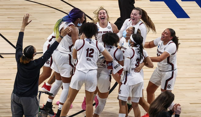 The South Carolina players celebrate after beating Texas and reaching their third Final Four under coach Dawn Staley.