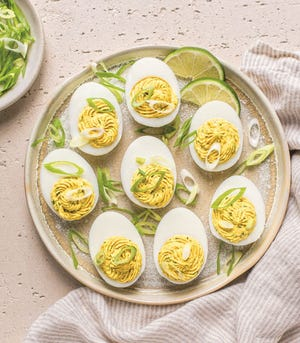 These curried deviled eggs are one way to use up hard-boiled eggs leftover at Easter.