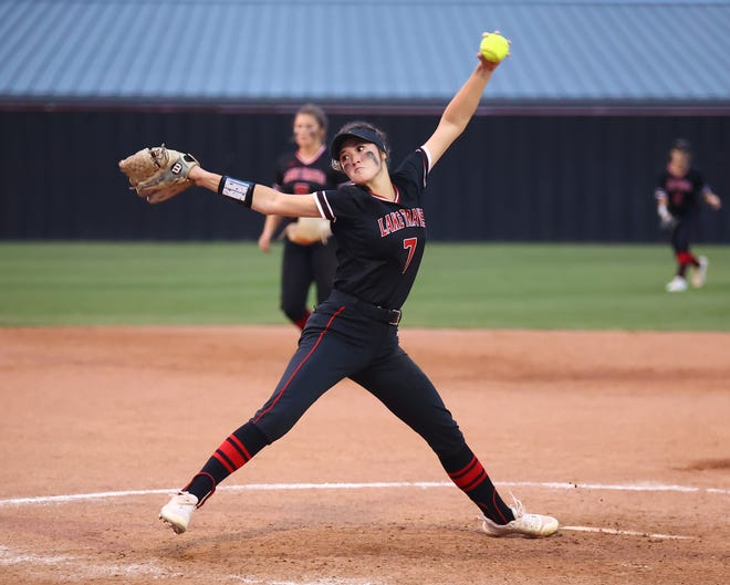 Lake Travis pitcher Paige Connors winds up the fourth inning against Westlake during District 26-6A softball action March 30 at Lake Travis High School. Connors threw a no-hitter as the Cavs improved to 6-1 in district play with an 8-0 win.