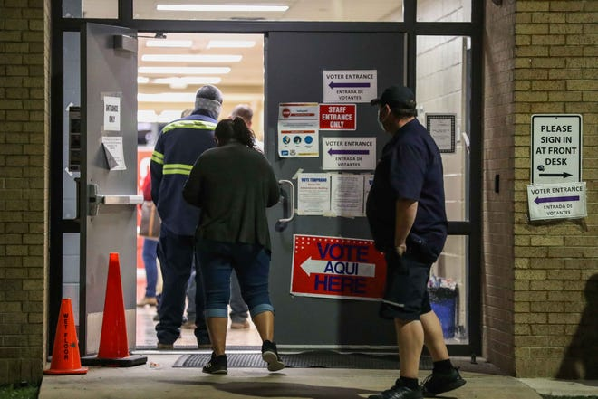 Voters enter the Manor ISD Administration building on Nov. 3 to cast their vote.