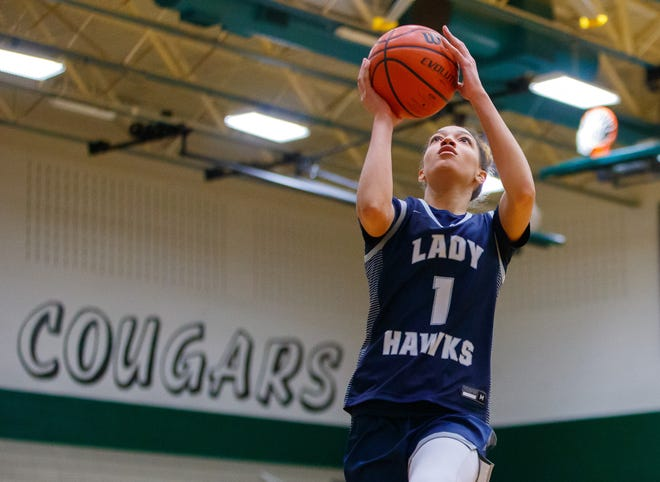 Hendrickson senior Zoe Nelson, making a layup against Connally in February, helped the Hawks go 124-24 during her four seasons on the varsity.