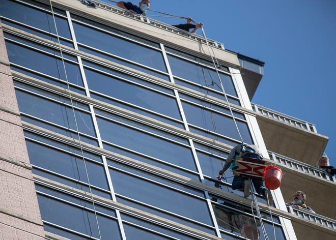Austin rescue crews on Thursday saved a man who was left stranded and dangling from a rope on the side of a downtown Austin skyscraper, Austin-Travis County EMS officials said.