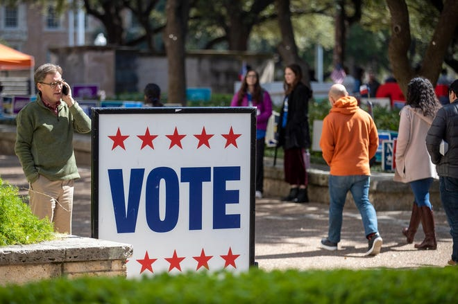 University of Texas Students walk an early voting site in on the campus of University of Texas, Tuesday, Feb. 18, 2020. Early primary voting for began Tuesday for Texas and Arkansas ahead of Super Tuesday 2020.