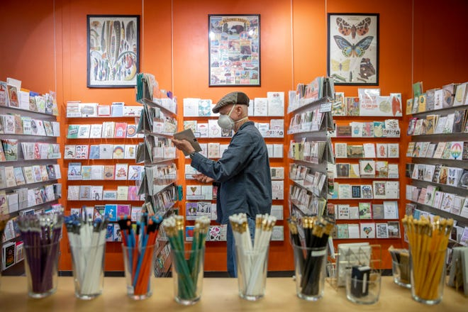 Herb Long shops for a sympathy card at Paper Place on April 1. The store on North Lamar was closed the entire month of April amid the COVID pandemic, but customers are returning, says owner Suzy Ranney.