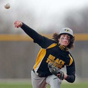 Cuyahoga Falls starting pitcher Damien Smith delivers a pitch to a Hoban batter during the first inning of a baseball game, Wednesday, March 31, 2021, in Akron, Ohio. [Jeff Lange/Beacon Journal]