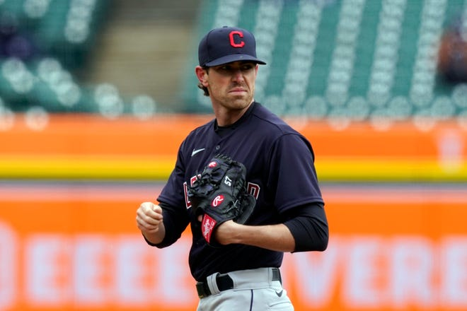 Cleveland starting pitcher Shane Bieber gave up three runs in the first two innings in a 3-2 loss to the Detroit Tigers on Opening Day. [Carlos Osorio/Associated Press]