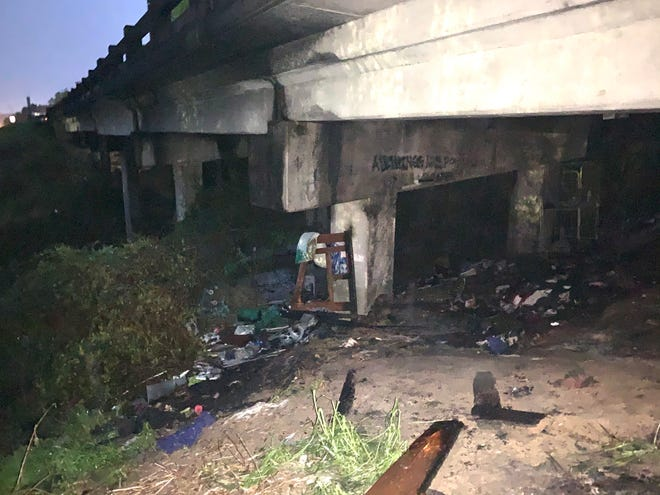 A homeless camp under the North Leg Road bridge was set ablaze Wednesday, March 31. The road in closed pending a bridge inspection.