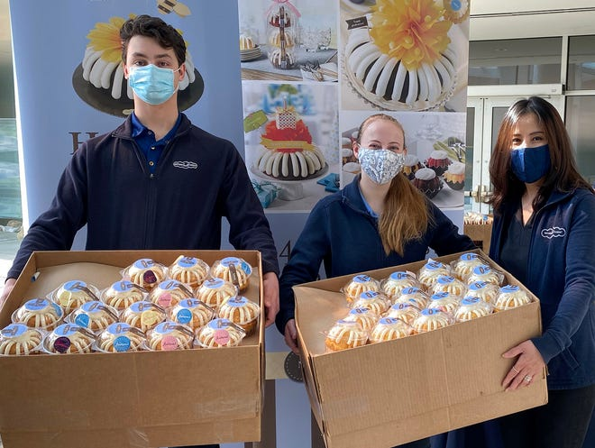 Evan Quinn, manager; Stephanie Sinclair, manager; and Jeannie Kim, owner of Nothing Bundt Cakes in Warrington, delivered 1,661 individually-wrapped miniature bundt cakes to physicians and associates in Doylestown Hospital's more than 80 departments.