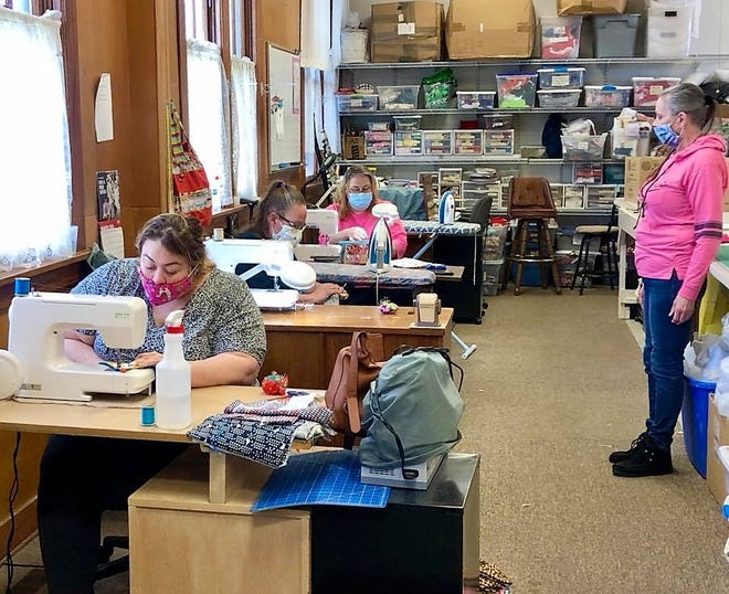 Martha's Task seamstresses work Wednesday sewing hot pads in class on new Baby Lock machines donated by B-Sew Inn.