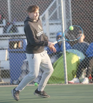 Boonville's Travel Dell hits a backhand while playing No. 6 singles Wednesday night against Marshall at the high school tennis courts. Dell fell to Marshall's Malik Evans by a score of 8-0. The Pirate netters also lost the match against Marshall 9-0, dropping to 0-3 on the season.