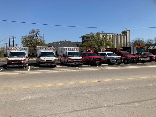 The Central Fire Station in Brownwood was one of numerous locations throughout Texas where emergency response vehicles were briefly parked Thursday afternoon, lights flashing, in honor of DPS trooper Chad Walker.